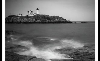 Maine Nubble Lighthouse And Rocky Shores In Bw